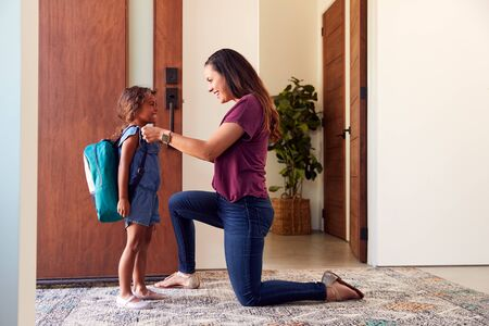 Mother Saying Goodbye To Daughter As She Leaves Home For School