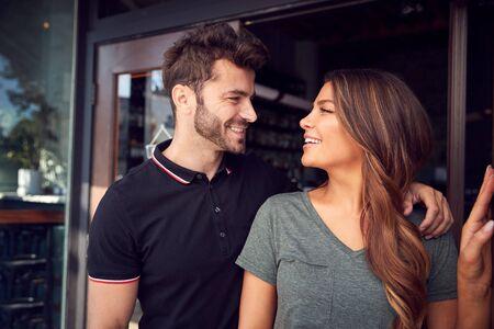 Couple Starting New Coffee Shop Or Restaurant Business Standing In Doorway