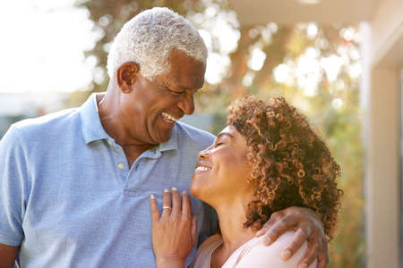 Portrait Of Smiling Senior African American Couple In Garden At Home