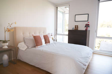 Interior View Of Beautiful Bedroom With Soft Furnishings In New Family House