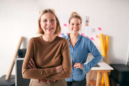 Portrait Of Two Women Running Creative Business In Studio Together