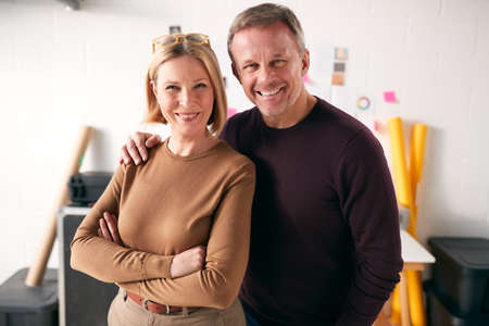 Portrait Of Mature Couple Running Creative Business In Studio Together Stockfoto