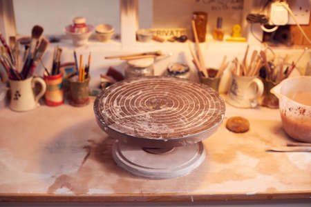 Turntable For Decorating Handmade Pottery On Workbench In Ceramics Studio