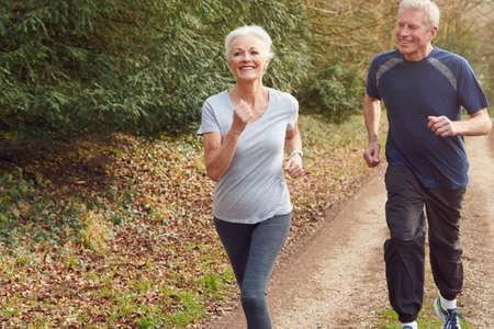 Senior Couple Exercising In Autumn Countryside During Covid 19 Lockdown Stock fotó