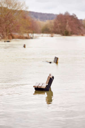 Benches Submerged As River Thames Floods And Bursts In Banks In UK