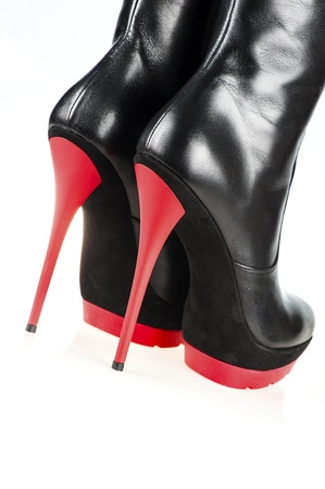 dominatrix: Close-up shot of a pair of fetish boots, high heels with platform, black and red color