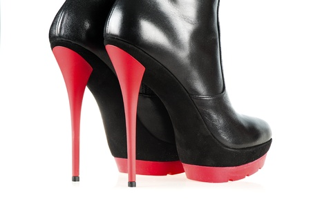 Close-up shot of a pair of fetish boots, high heels with platform, black and red color  Stock Photo - 16609202