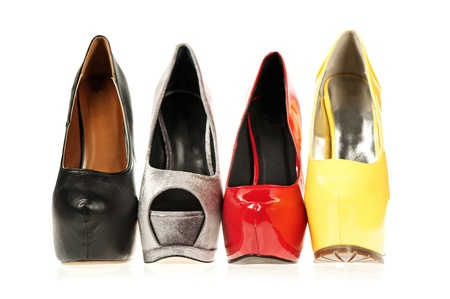 Four different High Heels shoes with inner platform soles. Stock Photo