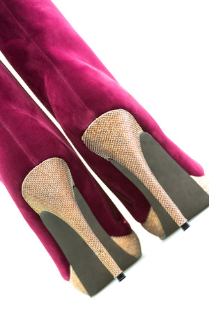 High Heels ankle boots in dark red suede leather and a shiny gold heel and sole Stock Photo