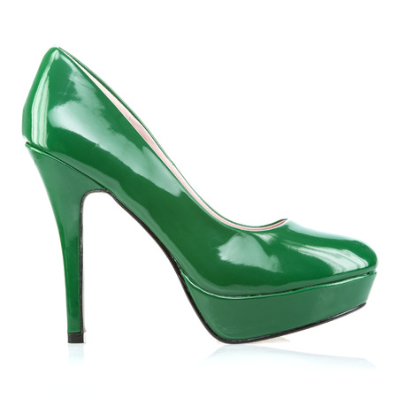 Fashionable platform High Heels in shiny green patent leather, isolated on white.