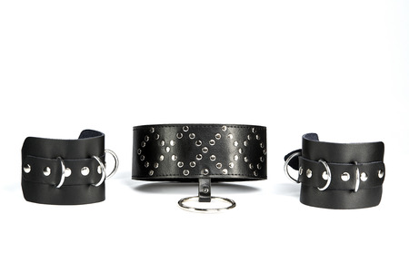 Fetish Hand cuffs and  collar a made of black leather photo