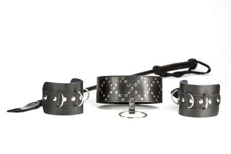 Fetish Hand cuffs, collar and whip made of black leather photo
