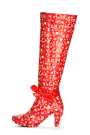 no heels: A high heels boot wrapped in Christmas paper.  Stock Photo