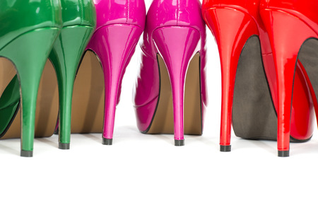 Details of the heels of three pairs of colorful high heels shoes.  Stock Photo