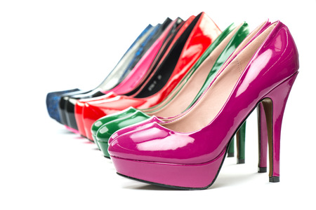 High Heels shoes in shiny patent leather in various colors.  Stock Photo
