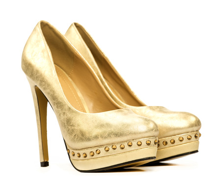 Elegant platform high heels shoes in gold and with rhinestone decoration