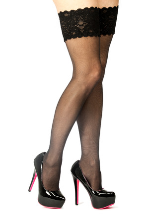 Sexy legs in black stockings and High Heels shoes with inner platform sole,black patent leather and pink sole.