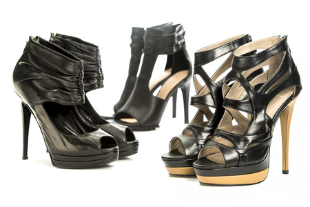 A group of three high heels shoes in various designs Stock Photo