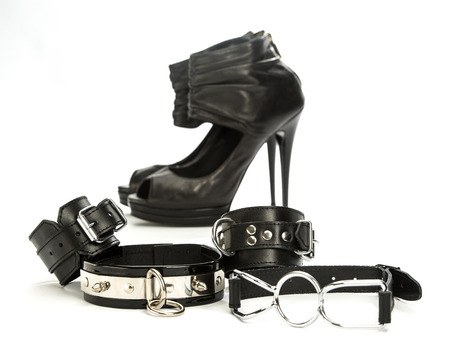 Various fetish stuff for role playing and BDSM: hand cuffs, a gag and high heels shoes