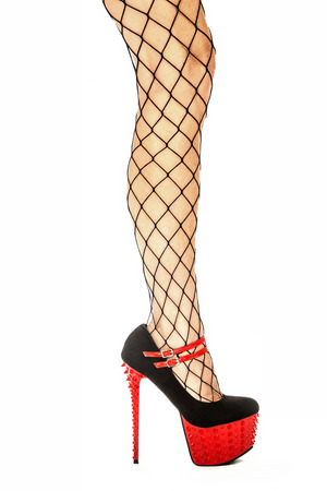 Sexy female legs in fishnet stockings and shiny red fetish high heels with extrem platform sole.