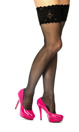 Sexy female legs in stockings and shiny pink fetish high heels with platform sole. Stock Photo
