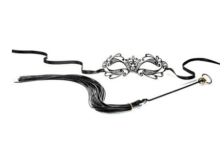 Fetish mask in venetian style and whip photo
