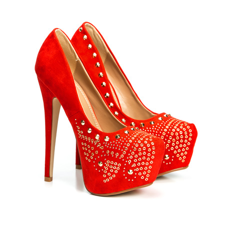 Fashionable High heels shoes in red and gold with inner platform an rhinestones. Isolated on while.