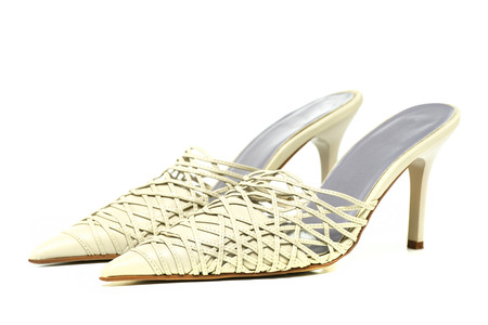 fashionable stiletto mules for summer, cut-out design with straps, kitten heels design. Stock Photo