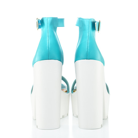 ankle strap: Top fashionable high heels shoes with platform and rugged white lug sole and an ankle-strap. Made of light blue faux leather;