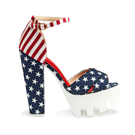fetish wear: Top fashionable high heels shoes with platform and rugged white lug sole and an ankle-strap. Design of the US flag with stars and stripes.
