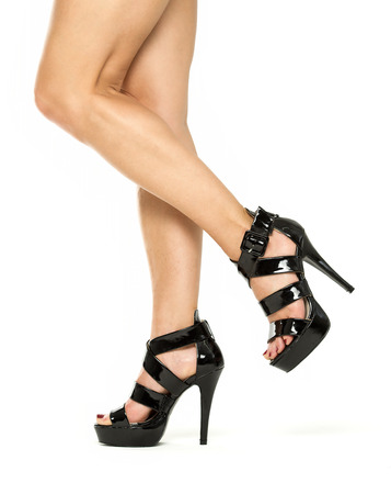 heel strap: Female legs in black high heels shoes with ankle straps, XXXL image Stock Photo
