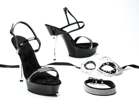 bdsm: Various fetish stuff for role playing and BDSM: mask, leather collar and shiny high heels shoes with rhinestones