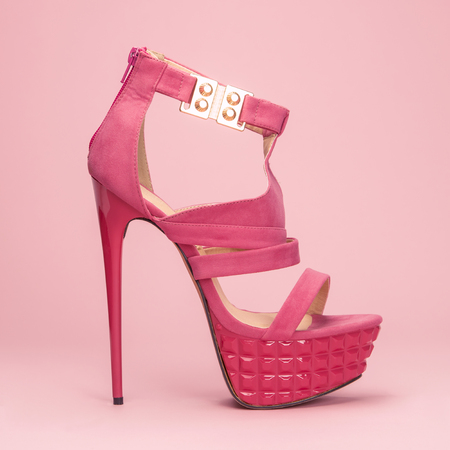 high heels shoe in pink on a pastel colored background, with platform sole and ankle strap, XXL image