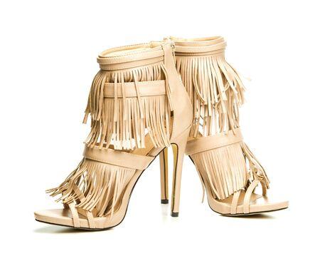 nude sex: high heels shoes booties in beigenude color, fringe design.