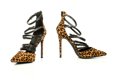 Stiletto high heels shoes in animal print design, with high heels shoe in brown suede and with platform sole in wood design; Stock Photo