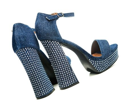 High heels shoes in denim colored fabric and rhinestones, with ankle-strap and platform sole.
