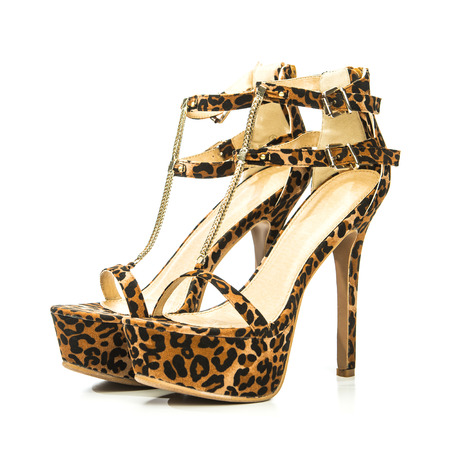Stiletto high heels shoes in animal print design, with high heels shoe in brown suede and with platform sole Stock Photo