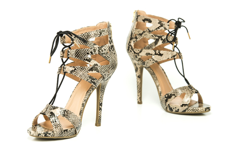 Fashionable strappy high heels shoes with small platform sole and ankle straps, animal print design.