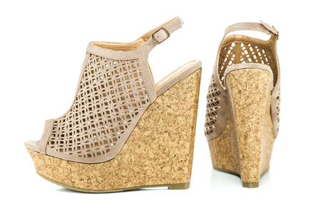 high heels shoe in nude color with rhinestones, wedges, platform sole in cork design and ankle strap, XXL image. Stock Photo