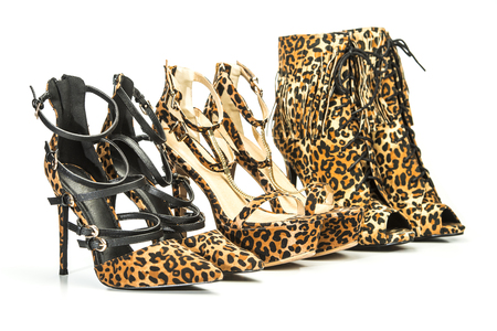 three pairs of high heels shoes and ankle boots in animal print design.