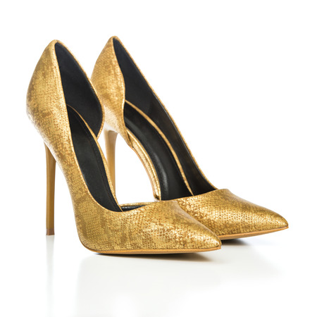 Classic stiletto high heels shoes in golden snake-print design. PLEASE NOTE: this is a no-name product from a chinese outdoor-market and not a branded designer product. Stock Photo