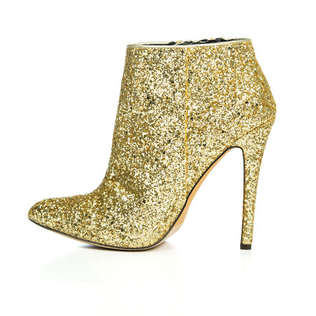 high heels ankle boots in golden sequin design, XXL image  PLEASE NOTE: this is a no-name product from a chinese outdoor-market and not a branded designer product. Stock Photo