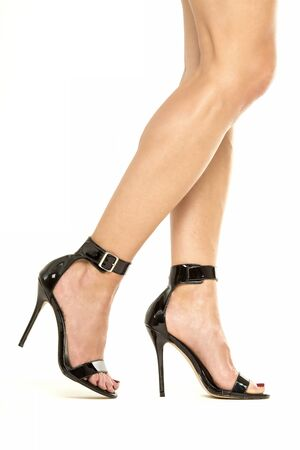 Female legs in black high heels shoes with ankle straps, XXXL image Stock Photo