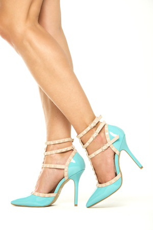 Female legs in blue high heels shoes with ankle straps, XXXL image Stock Photo