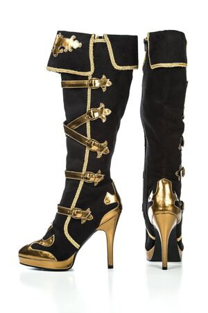 Extreme high heels boots with plateau sole in gold and black color