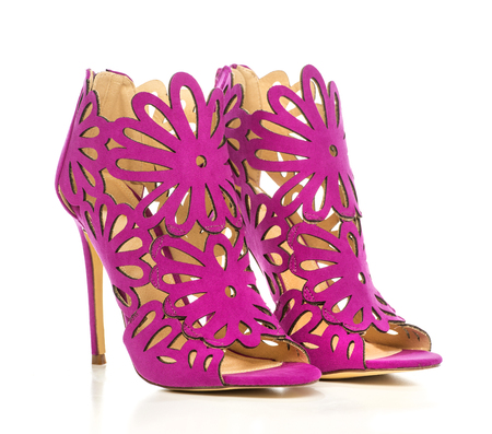 High Heels ankle boots in pinklilac suede with cut-out ornate design Stock Photo