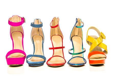 Five summer high heels strappy sandals in various colors and designs.