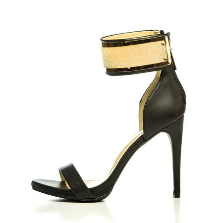 Fashionable High heels pumps in black with ankle strap in gold metal