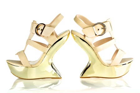 high heels shoe in beige and gold color with extravagant wedge-style platform sole and ankle strap.PLEASE NOTE: this shoes are no-name products for a chinese street-market and NO branded designer product!