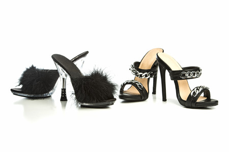 Two different fetish style high heels mules with a  faux fur pom-pom and metallic decoration.   Please note that these shoes are no-name product from a chinese retail-market and NO branded designer products.